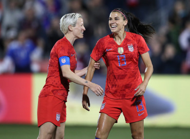 United states forward Alex Morgan (13) celebrates scoring her 100th goal with Megan Rapinoe.