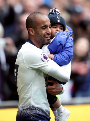Tottenham's Lucas Moura celebrates with his son after the win against Huddersfield Town.