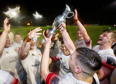 The Trinity players celebrate another Colours title.