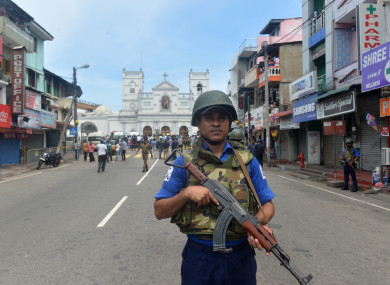 A soldier stands guard in front of the St. Anthony's Church in Colombo.