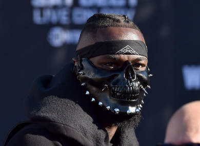 A masked Deontay Wilder preparing for his weigh-in with Tyson Fury last winter.