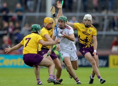 Brian Concannon is tackled by Damien Reck and Rory O'Connor.