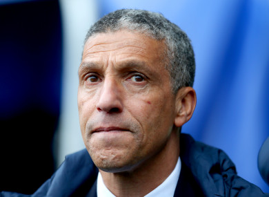 Chris Hughton watches on during Brighton's 4-1 defeat to Manchester City on the final day of the Premier League season.