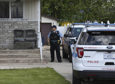 Police watch a home in Chicago during their search for Marlen Ochoa-Uriostegui yesterday