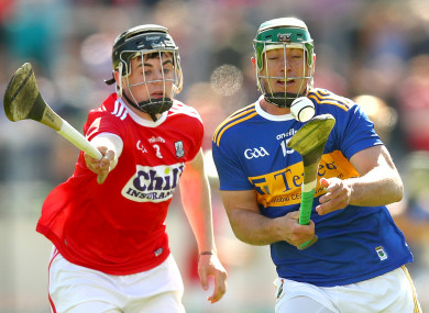 Cork's Darragh Fitzgibbon in action against Tipperary's John O'Dwyer.