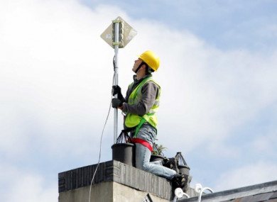 A broadband engineer searches for a wireless signal from a rooftop in Athgarvan, Co Kildare.