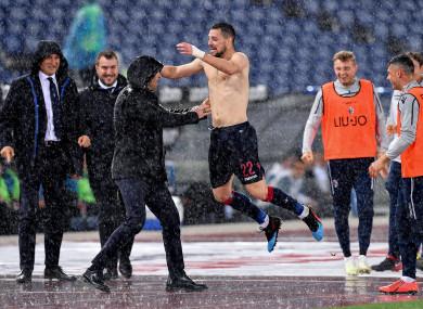 Safe: Bologna's Mattia Destro celebrates.