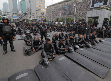 Police seen guarding the barbed wire barricade in front of the Election Supervisory Agency building, Jakarta, Indonesia