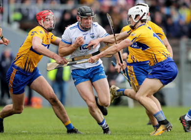 Clare and Waterford players in action in Walsh Park in March.