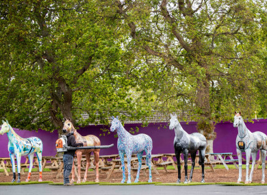 Leopardstown staff put the finishing touches to some ornamental horses before racing this evening.