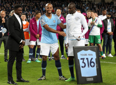 Yaya (right) alongside City captain Vincent Kompany and his brother Kolo Toure (left) after his final Premier League match at the Etihad Stadium in May 2018.