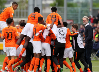 Manager Peter Van Der Veen watches his players celebrate Naci Unuvar's goal.