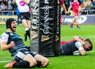 Ospreys celebrate as Olly Cracknell dives over for his side's second try.