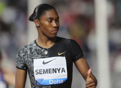 Caster Semenya gives a thumps up as she arrives to compete in the women's 800-meter final during the Diamond League in Doha, Qatar.