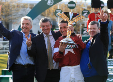 Michael and Eddie O'Leary celebrate the Grand National victory with jockey Davy Russell and trainer Gordon Elliott.
