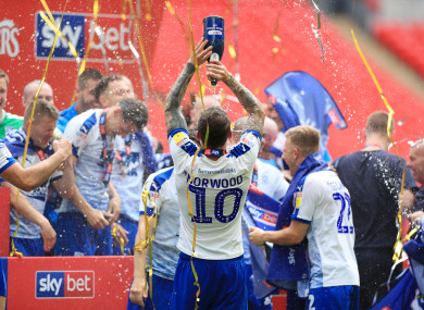 Tranmere players celebrate their dramatic play-off victory at Wembley.
