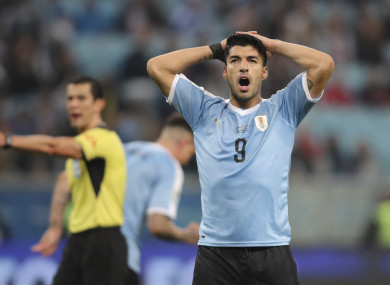 Suarez reacts to a missed chance.