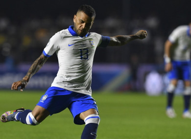 Dani Alves in action for Brazil against Bolivia.
