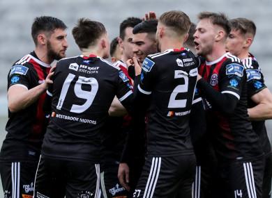 Bohemians' Daniel Mandroiu celebrates scoring a goal with team-mates.
