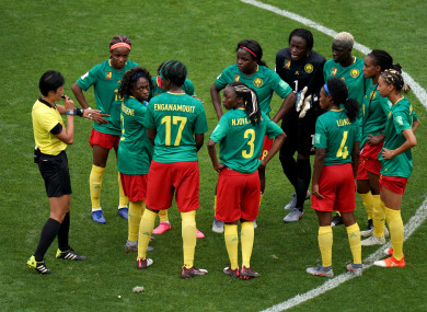 Cameroon players protest England's second goal.