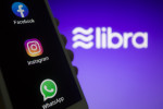 Stock photo of Facebook-owned apps against Libra Association logo