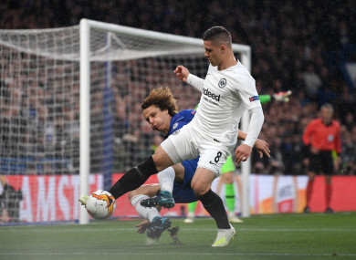 Jovic shields the ball from Chelsea defender David Luiz during their Europa League encounter.