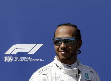 All smiles: Hamilton.