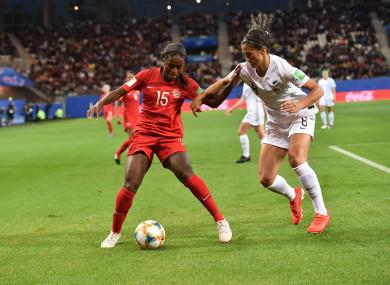 Goalscorer Nichelle Prince battles for the ball with Abby Erceg.