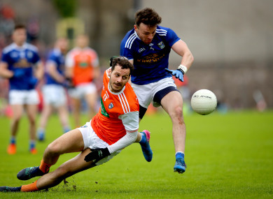 Jamie Clarke and Conor Moynagh battling for possession in the Ulster SFC semi-final.