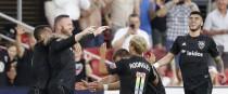 Wayne Rooney celebrates with his team-mates.