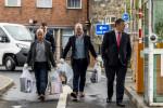 Investigative journalists Barry McCaffrey (left) and Trevor Birney carry returned documents in Belfast.