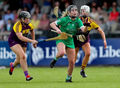 Limerick's Rebecca Delee with Wexford's Shauna Sinnott and Linda Bolger.