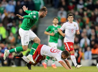 Ireland's Richard Keogh and Tjay De Barr of Gibraltar.