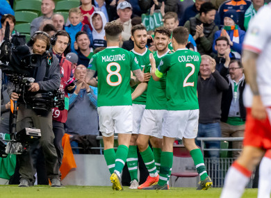 Sean Maguire (8) celebrates Robbie Brady's late goal with his team-mates.