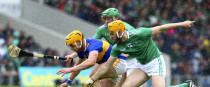 Tipperary's Ronan Maher is tackled by Limerick's Seamus Flanagan and Shane Dowling.