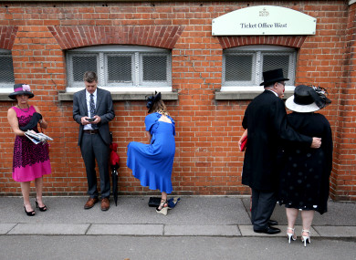 Racegoers arrive at Ascot Racecourse this week.