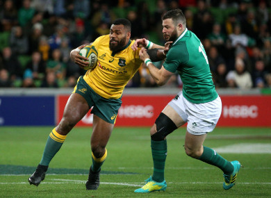 Australia's Samu Kerevi under pressure from Ireland's Robbie Henshaw during their game in Melbourne on 16 June, 2018.