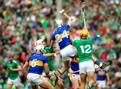 Tipperary and Limerick players battle for possession.