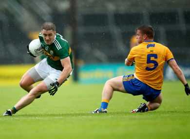 Stephen O'Brien runs at the Clare defence.