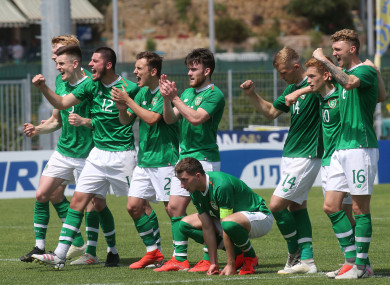 Ireland players celebrate Adam Idah scoring a penalty during Saturday's shoot-out.