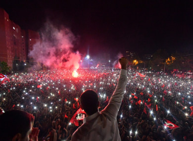 Ekrem Imamoglu waves to his supporters following his victory in Istanbul.