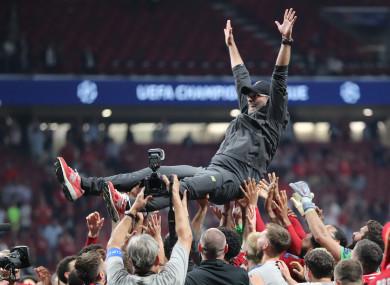 Liverpool players lift manager Jurgen Klopp after winning the Champions League.
