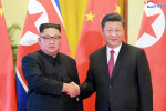 North Korean leader Kim Jong Un visiting Chinese President Xi Jinping in Beijing.