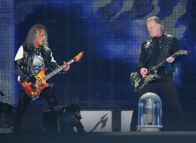 Kirk Hammett (L) and James Hetfield perform in concert at the Stade de France near Paris on 12 May.