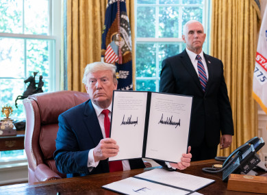 US President Donald Trump poses for a picture after signing an Executive Order to place further sanctions on Iran