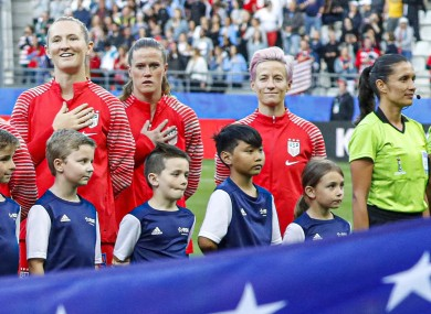 Megan Rapinoe (right) boycotts the national anthem ahead of the USA's game with Thailand.