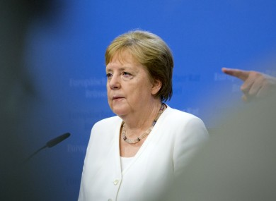 German Chancellor Angela Merkel takes questions during a media conference at the EU summit in Brussels yesterday