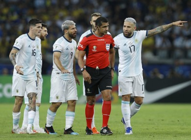 Referee Roddy Zambrano is surrounded by Argentina players during their Copa America defeat to Brazil.