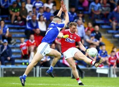 Cork's Brian Hurley and Laois defender Patrick O'Sullivan.