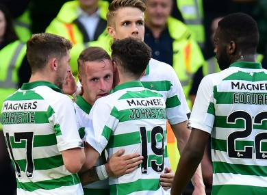 Celtic players celebrate after Leigh Griffiths' goal.